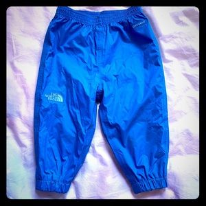 North Face- blue Rain Pants. 6-12 mo.
